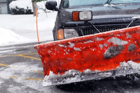 Work truck with snow plow, plowing residential driveways